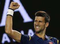 Serbia's Novak Djokovic celebrates after winning his quarter-final match against Japan's Kei Nishikori at the Australian Open tennis tournament at Melbourne Park, Australia, January 26, 2016. REUTERS/Issei Kato