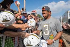 January 27, 2016; Wahiawa, HI, USA; Seattle Seahawks quarterback Russell Wilson (3) signs autographs during the 2016 Pro Bowl Draft at Wheeler Army Airfield. Mandatory Credit: Kyle Terada-USA TODAY Sports
