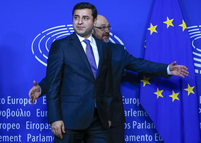 Selahattin Demirtas (L), co-leader of the pro-Kurdish Peoples' Democratic Party (HDP) is welcomed by European Parliament President  Martin Schulz in Brussels January 27, 2016.  REUTERS/Yves Herman