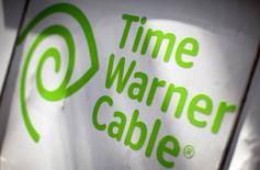 A Time Warner Cable sign and logo are seen on the back of a Time Warner Cable service truck in the Manhattan borough of New York City, May 26, 2015.  REUTERS/Mike Segar