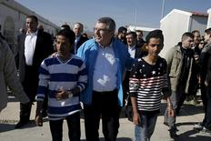 International Olympic Committee President (IOC) Thomas Bach (C) walks along with migrants during a guided media tour at the Eleonas refugee camp in Athens, Greece, January 28, 2016.  REUTERS/Alkis Konstantinidis