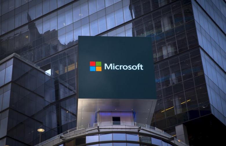 The Microsoft logo is seen on an electronic billboard on an office building in New York City, July 28, 2015. REUTERS/Mike Segar