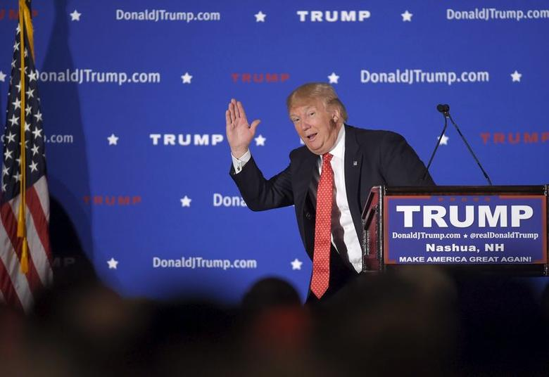 U.S. Republican presidential candidate Donald Trump pantomimes a candidate with low poll numbers as he address the audience at a campaign rally in Nashua, New Hampshire January 29, 2016.      REUTERS/Gretchen Ertl     . SAP is the sponsor of this coverage which is independently produced by the staff of Reuters News Agency.