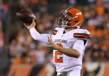 Cleveland Browns quarterback Johnny Manziel (2) throws a pass in the second half against the Cincinnati Bengals at Paul Brown Stadium.  Aaron Doster-USA TODAY Sports