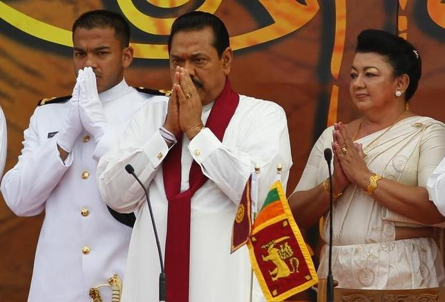 Then Sri Lankan President Mahinda Rajapaksa (C) prays with his son Yoshitha (L), and wife Shiranthi before taking the oath of office for a second term, in Colombo November 19, 2010. REUTERS/Andrew Caballero-Reynolds/Files