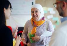 """Hiba Albassir, migrant from Damascus, attends a workshop called """"Refugee Entrepreneurship Action Lab"""" in Berlin, Germany, January 30, 2016. REUTERS/Hannibal Hanschke"""