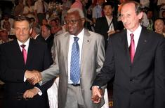 International Association of Athletics Federations (IAAF) President Lamine Diack (C) holds hands with Valentin Balakhnichev (R), President of the All-Russia Athletic Federation, and Valery Vinogradov, Deputy Mayor of Moscow, in Kenya's coastal town of Mombasa March 27, 2007 REUTERS/Joseph Okanga