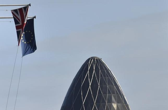 A British Union Jack flag and an European Union flag fly from a building, with the 'Gherkin' skyscraper seen in the City of London financial district in London, Britain, January 30, 2016.  REUTERS/Toby Melville