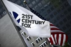 The flag of the Twenty-First Century Fox Inc is seen waving at the company headquarters in the Manhattan borough in New York June 11, 2015. REUTERS/Eduardo Munoz
