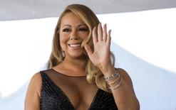 Recording artist Mariah Carey attends the ceremony for the unveiling of her star on the Hollywood Walk of Fame in Los Angeles, California August 5, 2015.  REUTERS/Mario Anzuoni