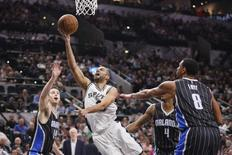 Feb 1, 2016; San Antonio, TX, USA; San Antonio Spurs point guard Tony Parker (9) shoots the ball as Orlando Magic power forward Jason Smith (14) defends during the first half at AT&T Center. Mandatory Credit: Soobum Im-USA TODAY Sports -