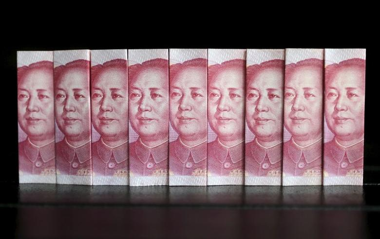 Chinese 100-yuan banknotes are seen in this file picture illustration taken in Beijing July 11, 2013.  REUTERS/Jason Lee