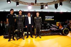 Renault Chief Executive Carlos Ghosn (2ndR), Renault Formula One racing driver Kevin Magnussen of Denmark (R) and teammate Jolyon Palmer of Britain (2ndL), and reserve driver Esteban Ocon (L) pose during the official presentation of the new Renault RS16 car at the company's research center, the Technocentre, in Guyancourt, near Paris, France, February 3, 2016. REUTERS/Benoit Tessier
