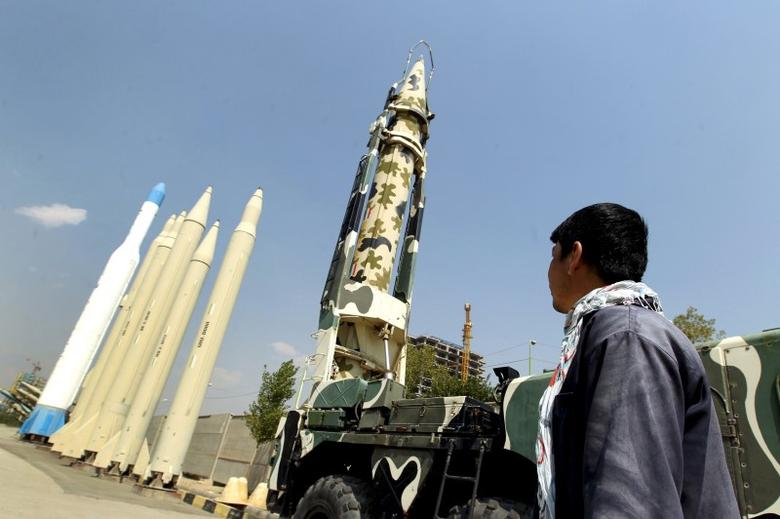 A man looks at Iranian-made missiles at Holy Defence Museum in Tehran in this September 23, 2015 file photo.   REUTERS/Raheb Homavandi/TIMA/Files