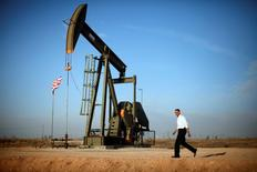 President Obama walks past a pumpjack on his way to deliver remarks on energy independence in New Mexico, March 2012.    REUTERS/Jason Reed