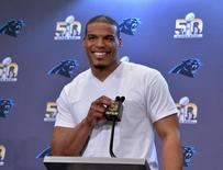 Feb 2, 2016; San Jose, CA, USA; Carolina Panthers quarterback Cam Newton addresses the media at press conference prior to Super Bowl 50 at the San Jose McNery Convention Center. Mandatory Credit: Kirby Lee-USA TODAY Sports -