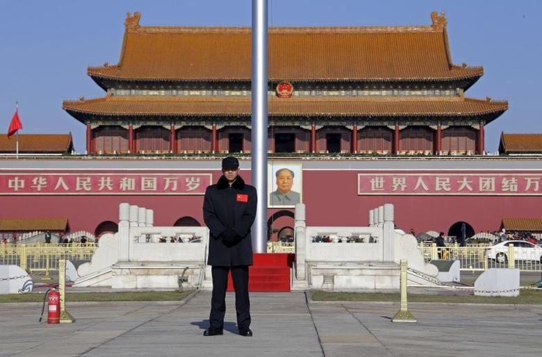 A security guard keeps watch at Tiananmen Square in Beijing, December 10, 2015. REUTERS/Jason Lee