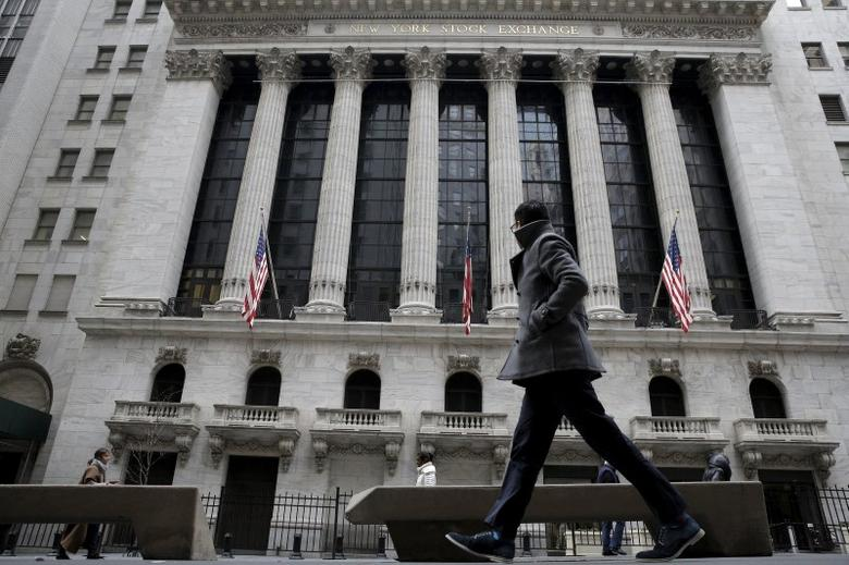 A man passes by the New York Stock Exchange in New York's financial district January 15, 2016. REUTERS/Brendan McDermid