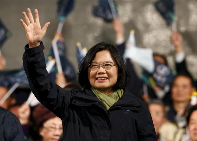 Democratic Progressive Party (DPP) Chairperson and presidential candidate Tsai Ing-wen waves to her supporters after her election victory at party headquarters in Taipei, Taiwan January 16, 2016. REUTERS/Pichi Chuang
