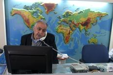 Palestinian travel agent Nabil Shurafa speaks on a phone at his office in Gaza City February 4, 2016.  REUTERS/Ibraheem Abu Mustafa
