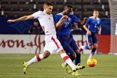 Feb 5, 2016; Carson, CA, USA; Canada defender Doneil Henry (4) and United States forward Jozy Altidore (17) battle for the ball during the first half at StubHub Center. Mandatory Credit: Kelvin Kuo-USA TODAY Sports