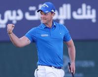 Danny Willett of England celebrates after winning the Dubai Desert Classic golf championship February 7, 2016. REUTERS/Ahmed Jadallah