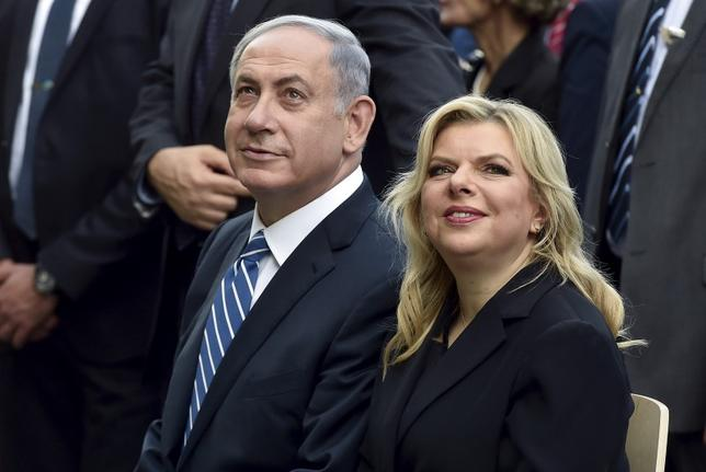 Israel's Prime Minister Benjamin Netanyahu (L) sits next to his wife Sara during a visit at the Expo 2015 global fair in Milan, northern Italy, August 27, 2015. REUTERS/Flavio Lo Scalzo/Files
