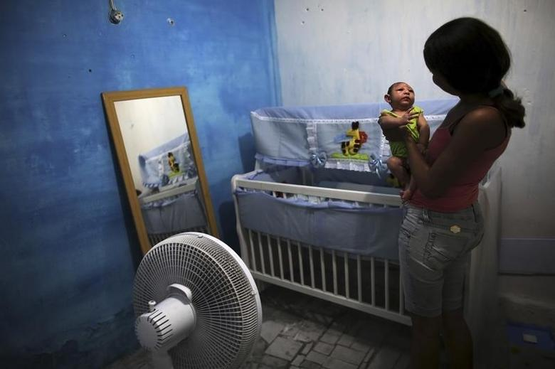Daniele Santos, 29, holds her son Juan Pedro who is 2-months old and born with microcephaly, at their house in Recife, Brazil, February 9, 2016.  REUTERS/Nacho Doce