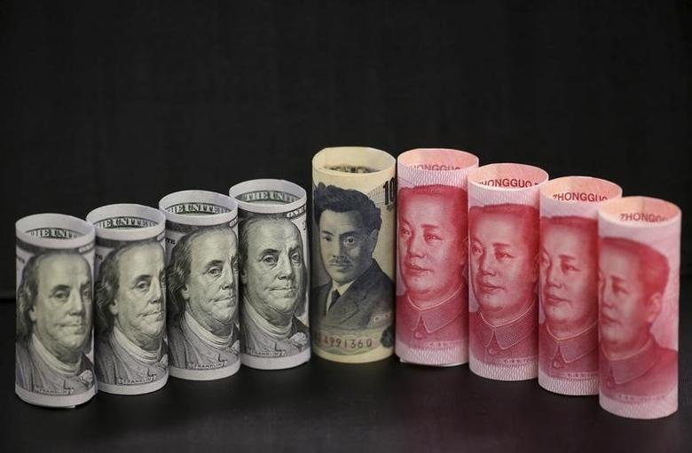 U.S. 100-dollar banknotes, Chinese 100-yuan banknotes, and a Japanese 1000-yen banknote, are seen in a picture illustration in Beijing, China, January 21, 2016. REUTERS/Jason Lee