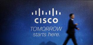 Рекламный щит  Cisco на Всемирном мобильном конгрессе в Барселоне. Производитель сетевого оборудования Cisco Systems сообщил о более существенном, чем ожидалось, росте квартальной прибыли за счёт повышенного спроса на маршрутизаторы и средства обеспечения безопасности. REUTERS/Albert Gea
