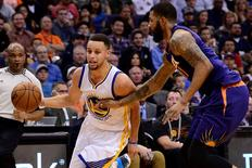 Feb 10, 2016; Phoenix, AZ, USA; Golden State Warriors guard Stephen Curry (30) handles the ball against Phoenix Suns forward Markieff Morris (11) at Talking Stick Resort Arena. The Golden State Warriors won 112-104. Mandatory Credit: Jennifer Stewart-USA TODAY Sports