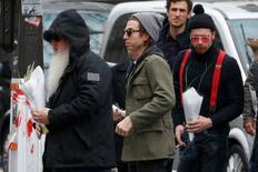 Dave Catching (L), Julian Dorio (C) and Jesse Hughes (R), members of Eagles of Death Metal band, arrive at the Bataclan concert hall to pay tribute to the shooting victims in Paris, France, December 8, 2015. REUTERS/Charles Platiau