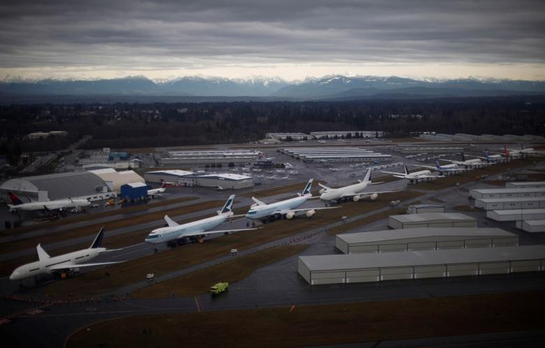 A line-up of Boeing 747s and 787 Dreamliners are pictured at the Boeing production facility in Everett, Washington, February 17, 2012.  REUTERS/Jason Reed
