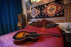 Replica items, including a guitar, in the bedroom of the home where Jimi Hendrix and girlfriend Kathy Etchingham lived in 1968-69  London, February 8, 2016.   REUTERS/Peter Nicholls