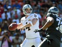 Jan 31, 2016; Honolulu, HI, USA; Team Rice quarterback Derek Carr of the Oakland Raiders (4) throws a pass during the 2016 Pro Bowl at Aloha Stadium.  Kirby Lee-USA TODAY Sports