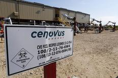 A warning sign is pictured near wellheads that inject steam into the ground and pump oil out at the Cenovus Energy Christina Lake Steam-Assisted Gravity Drainage (SAGD) project 120 km (74 miles) south of Fort McMurray, Alberta, August 15, 2013. REUTERS/Todd Korol