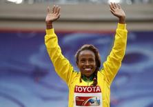 Gold medallist Meseret Defar of Ethiopia waves at the women's 5,000 metres victory ceremony during the IAAF World Athletics Championships at the Luzhniki stadium in Moscow August 17, 2013.  REUTERS/Grigory Dukor