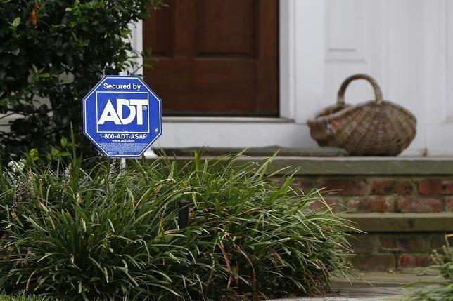 A security sign for ADT is seen outside a home in Port Washington, New York, September 30, 2014. REUTERS/Shannon Stapleton