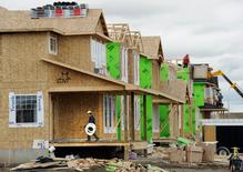 Construction workers work on building new homes in Calgary, Alberta, in this file photo taken on May 31, 2010. REUTERS/Todd Korol