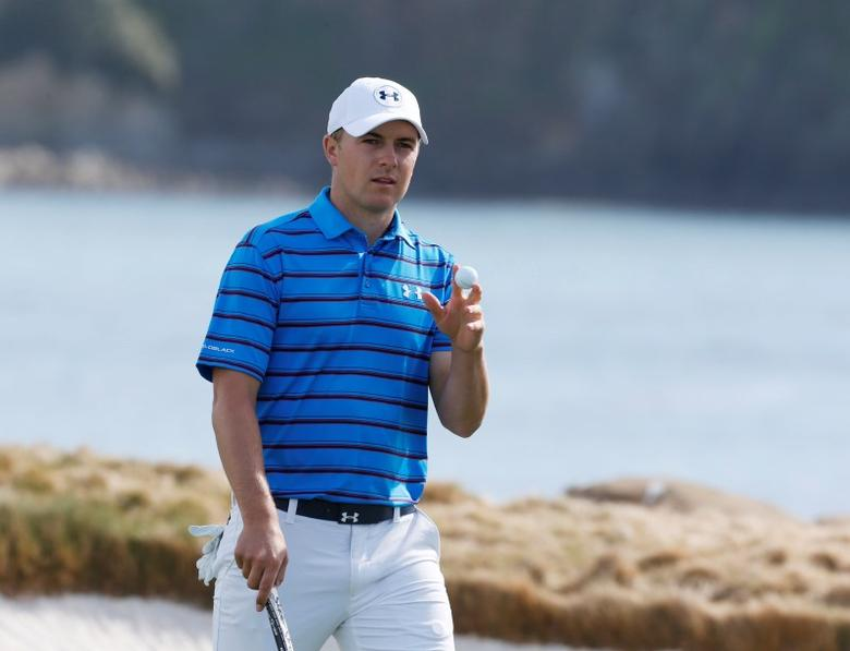 Feb 14, 2016; Pebble Beach, CA, USA; PGA golfer Jordan Spieth reacts to making a birdie putt on the 17th hole during the final round of the AT&T Pebble Beach National Pro-Am at Pebble Beach Golf Links. Mandatory Credit: Brian Spurlock-USA TODAY Sports