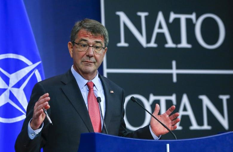 U.S. Secretary of Defense Ash Carter gestures during a news conference during a NATO Defence Ministers meeting at the Alliance's headquarters in Brussels, February 11, 2016.  REUTERS/Yves Herman