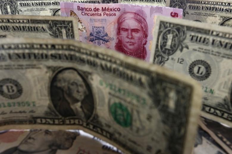 A picture illustration shows Mexican pesos and U.S. dollars banknotes in Mexico City July 6, 2015. REUTERS/Edgard Garrido