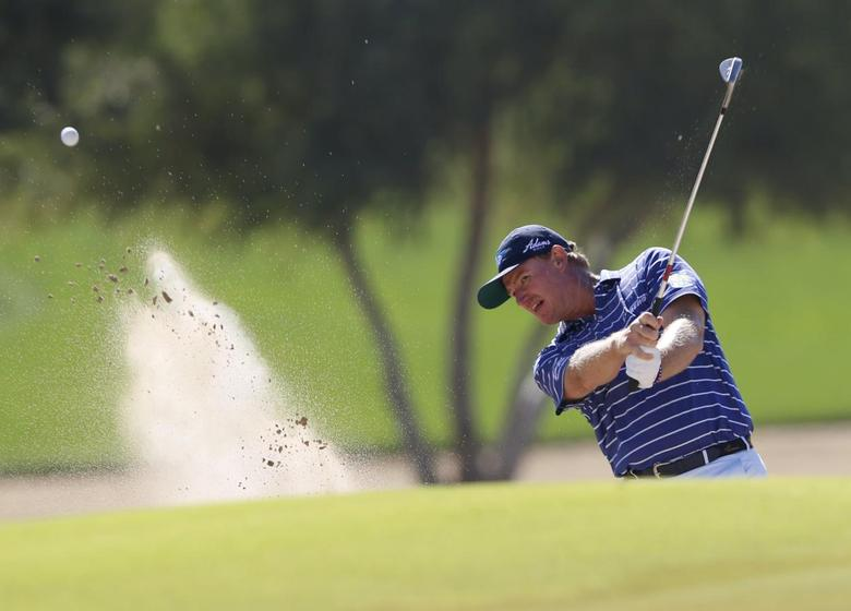 Ernie Els of South Africa hits the ball out of the bunker on the sixth hole during the Dubai Desert Classic golf championship February 6, 2016. REUTERS/Ahmed Jadallah