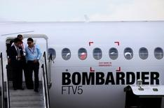 Visitors disembarks from a Bombardier C-Series aircraft displayed at the Singapore Airshow at Changi Exhibition Center February 18, 2016. REUTERS/Edgar Su