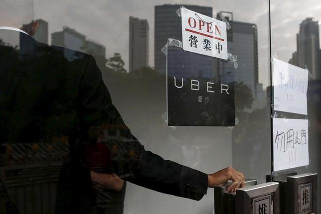 An open sign is seen at the office of taxi-hailing service Uber Inc during a driver recruitment event in Hong Kong, China, December 29, 2015. REUTERS/Tyrone Siu