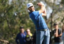 Dustin Johnson hits from the fourth hole tee during the second round of the Northern Trust Open golf tournament at Riviera Country Club. Mandatory Credit: Gary A. Vasquez-USA TODAY Sports