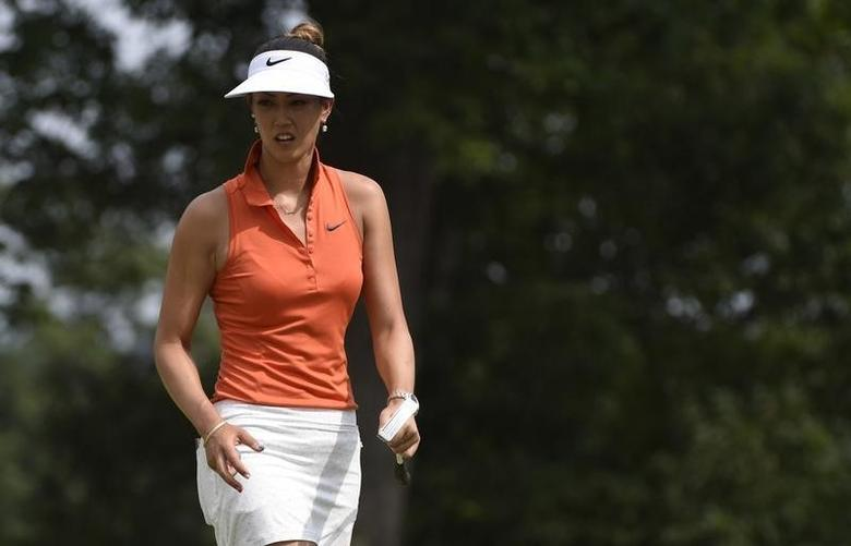 Jul 12, 2015; Lancaster, PA, USA; Michelle Wie reacts on the ninth hole during the final round of the U.S. Women's Open at Lancaster Country Club. Mandatory Credit: Kyle Terada-USA TODAY Sports
