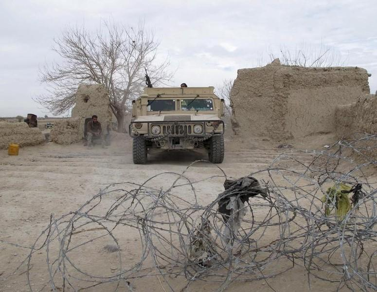 An Afghan National Army (ANA) vehicle is seen parked at an outpost in Helmand province, Afghanistan December 25, 2015. REUTERS/Abdul Malik