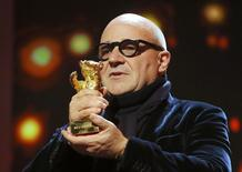 Director Gianfranco Rosi receives the Golden Bear - Best Film award for the movie 'Fuocoammare' (Fire at Sea) during the awards ceremony at the 66th Berlinale International Film Festival in Berlin, Germany, February 20, 2016.    REUTERS/Fabrizio Bensch