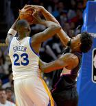 Feb 20, 2016; Los Angeles, CA, USA; Los Angeles Clippers center DeAndre Jordan (6) strips the ball from Golden State Warriors forward Draymond Green (23) in the second half of the game at Staples Center. The Warriors won 115-112. Mandatory Credit: Jayne Kamin-Oncea-USA TODAY Sports